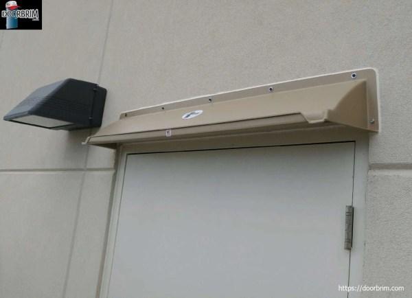 Affordable entrance door rain diverter or canopy mounts above door to stop leaks. Front gutter prevents dripping.