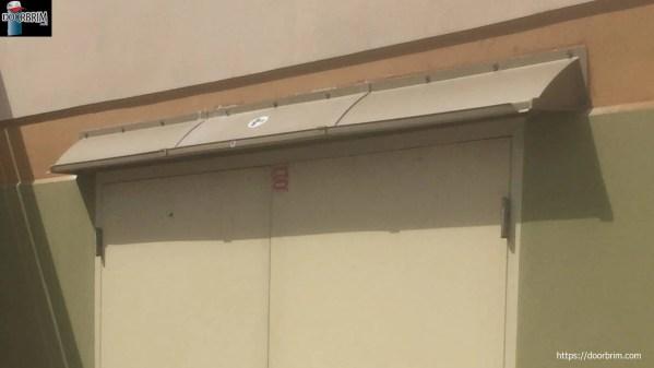 Image shows an extended width door canopy over 36 inch double doors.