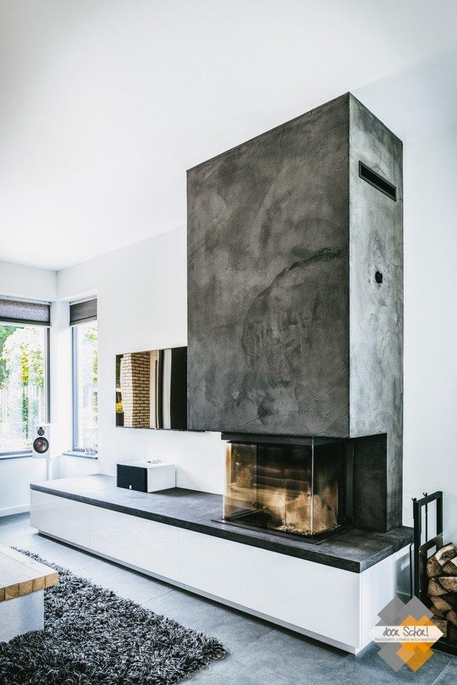 Betonstuc open haart met een maatwerk tv meubel