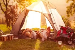 Couple sleeping in tent