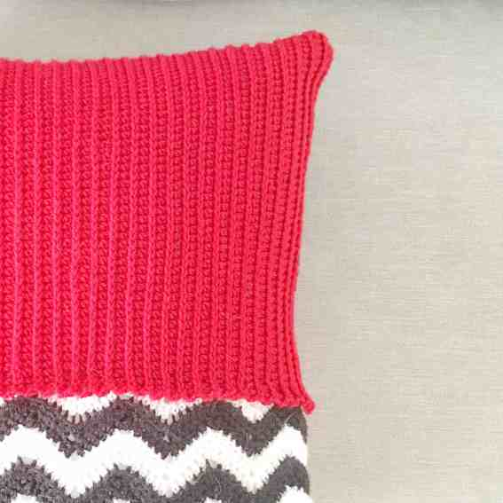 crochet cushion red and geometric zig zags