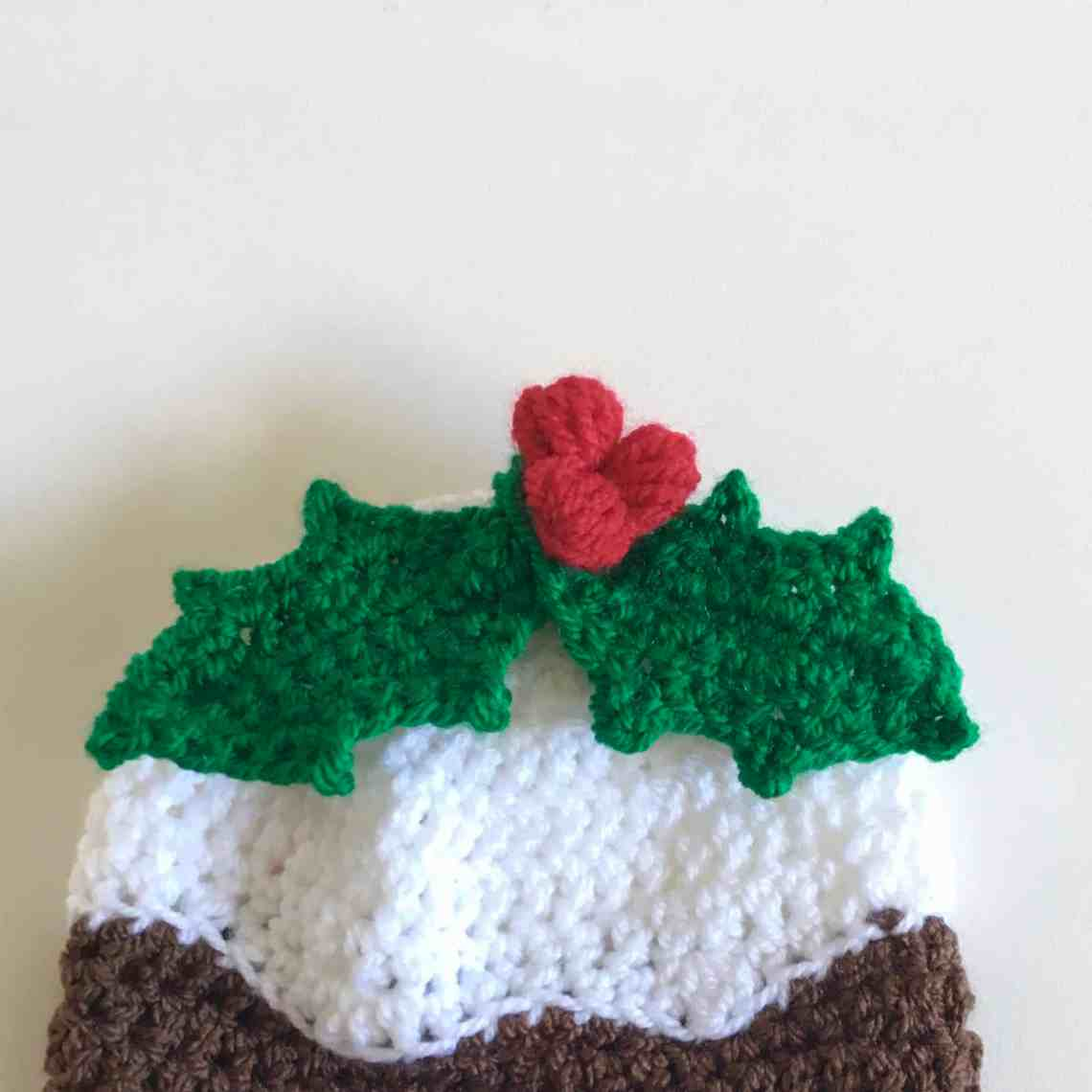 Christmas pudding crochet hat with holly sprig and berries