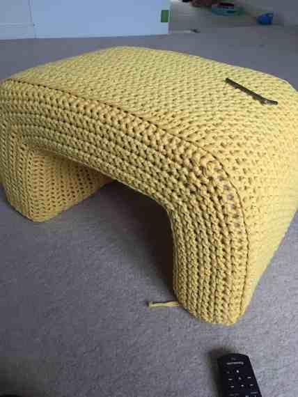 fast track lion brand yarn on footstool
