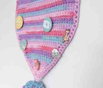crochet enamel pin pennant with pom pom