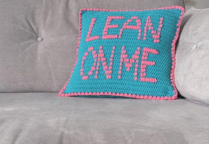Lean on me slogan crochet cushion