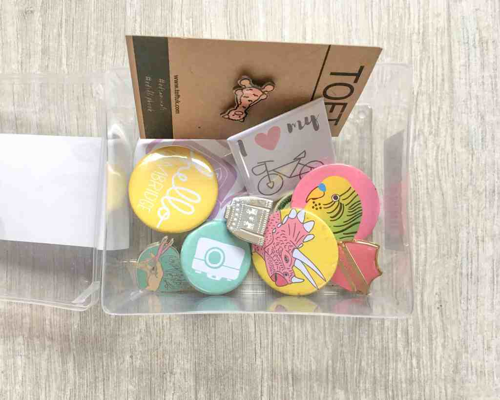 enamel pin and badge collection in box