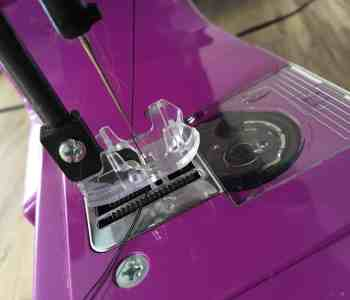 pink sewing machine needle threaded up
