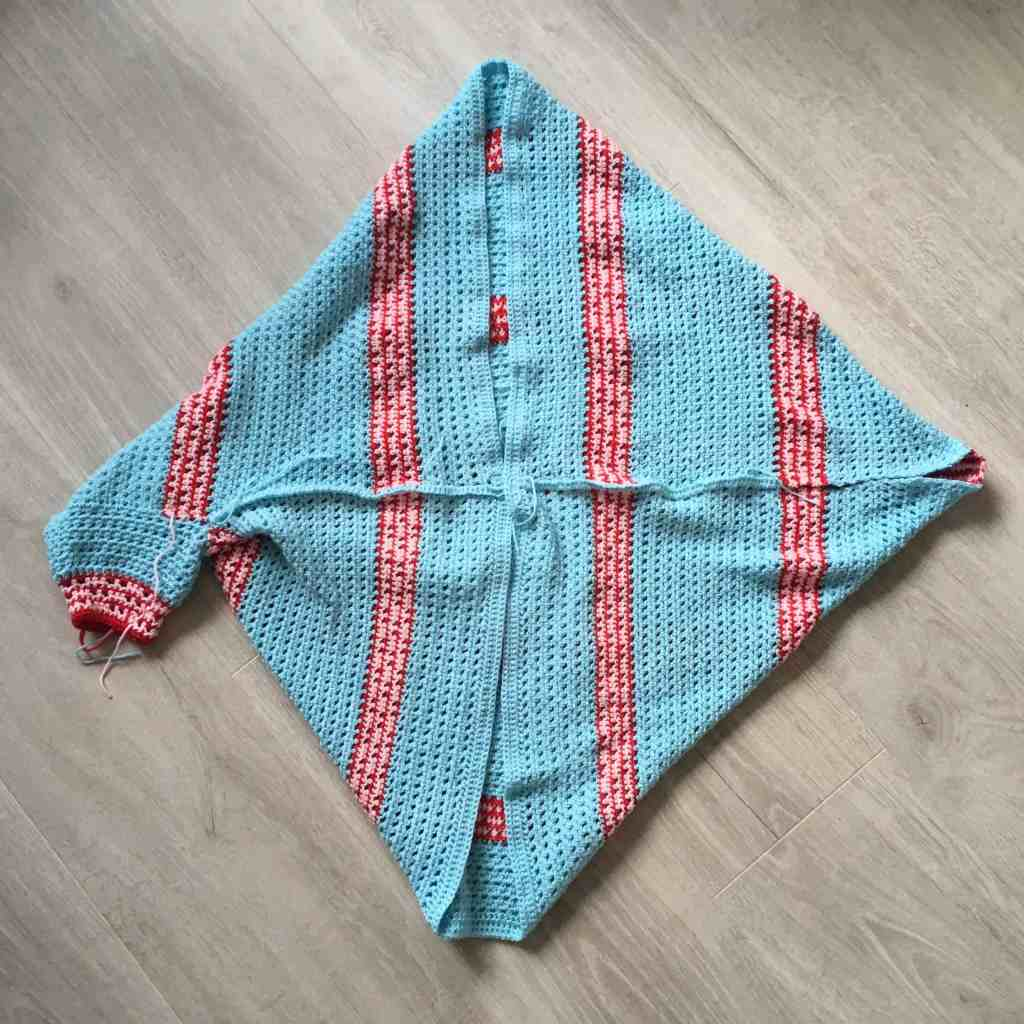 part made crochet shrug with one sleeve