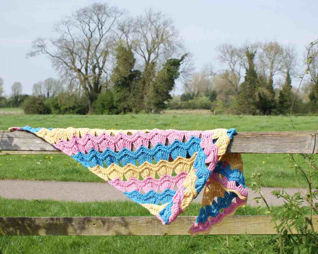 pink blue and yellow crochet shawl