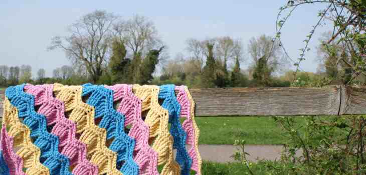 pink blue and yellow crochet shawl