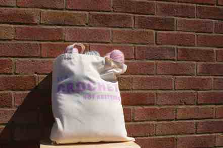 It's crochet not knitting project bag with yarn purple on cream