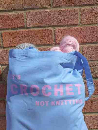 It's crochet not knitting blue cotton tote bag full of squishy yarn