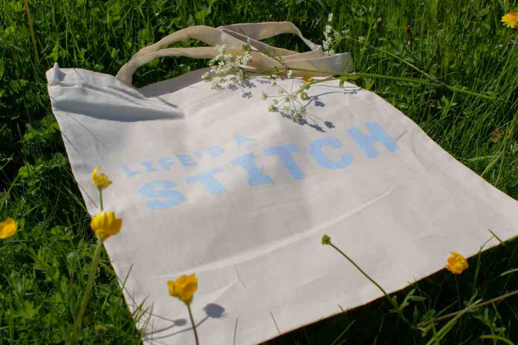 Life's a stitch natural cotton tote slogan bag