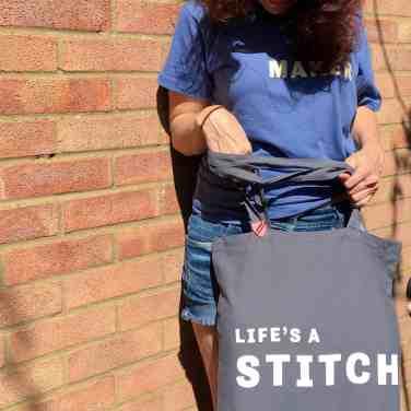 Lifes a stitch slogan tote with seamstress pin