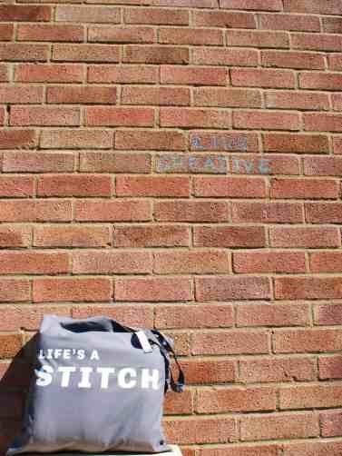 Life's a stitch slogan tote bag live creative graffiti