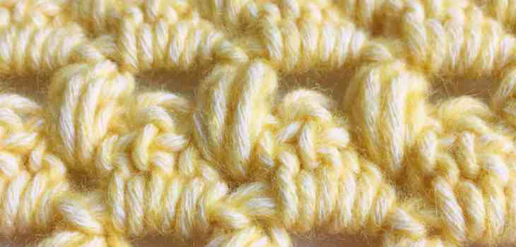 Granny dot crochet stitch close up of yarn and crochet stitches