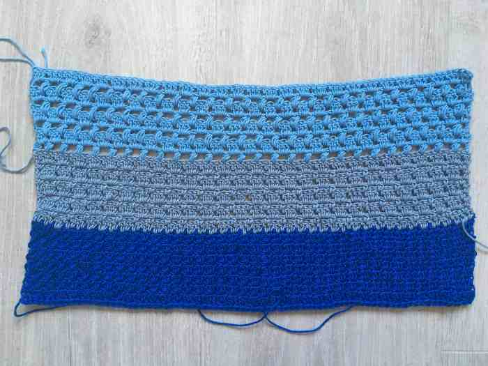 Crochet fabric stitch swatch in blue rainbow