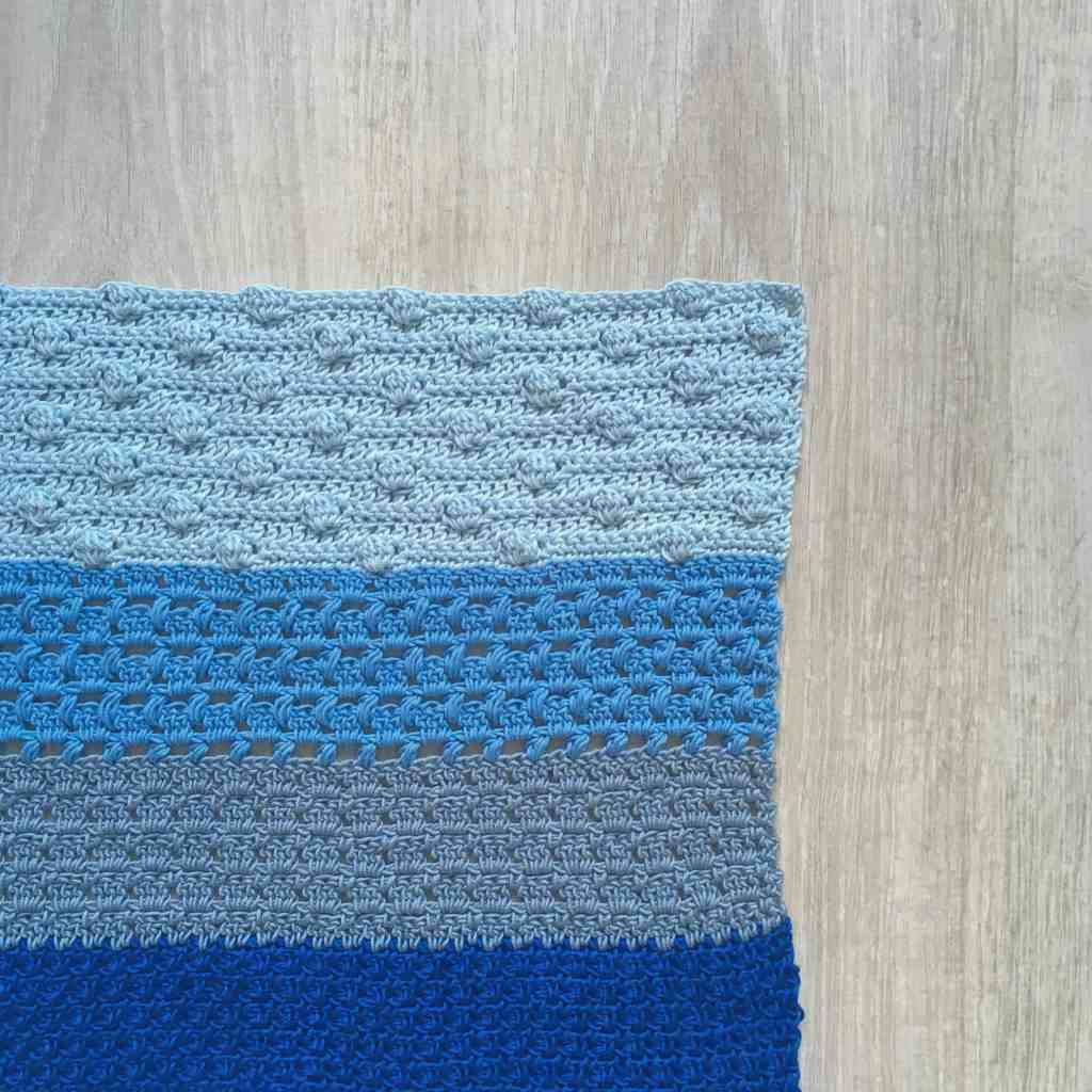 Crochet stitch tester fabric in shades of blue
