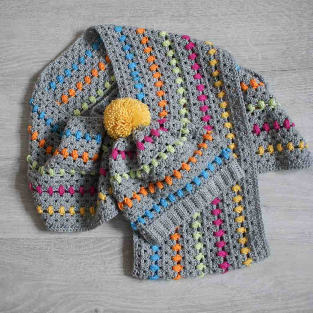 Rainbow and grey crochet pom pom hat