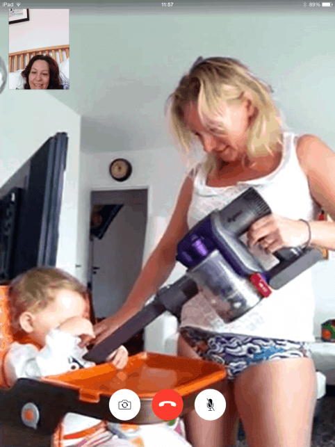 woman hoovering her baby