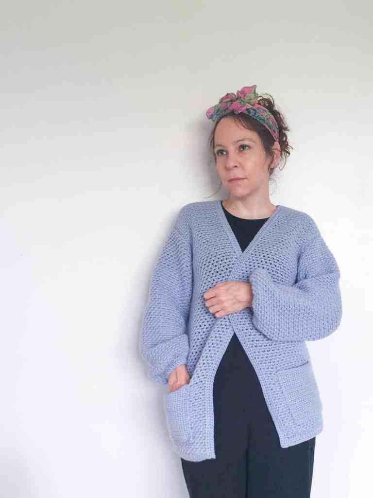Woman in crochet cardigan