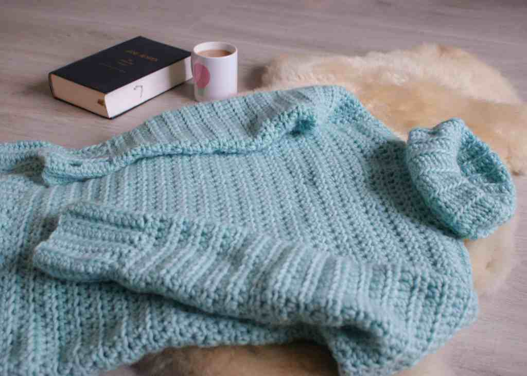 Cosy crochet sweater on sheep pelt