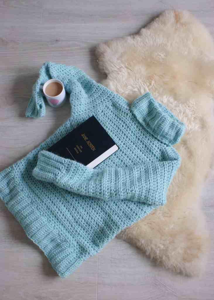Crochet Sweater in Aqua on sheepskin rug