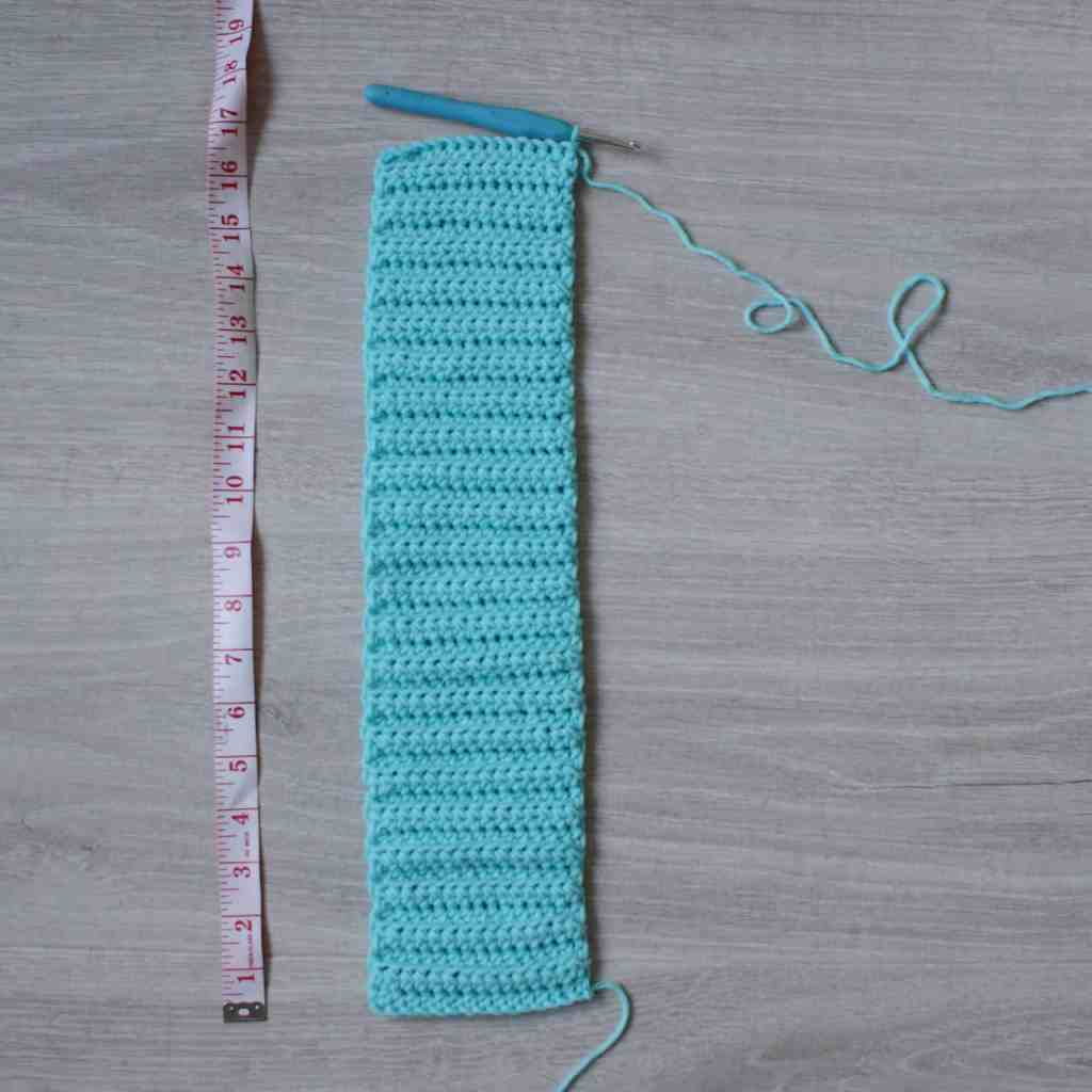 Strip of ribbed crochet next to tape measure