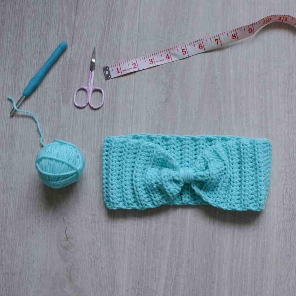 Crochet ear warmer,ball if yarn, hook, scissors and tape measure