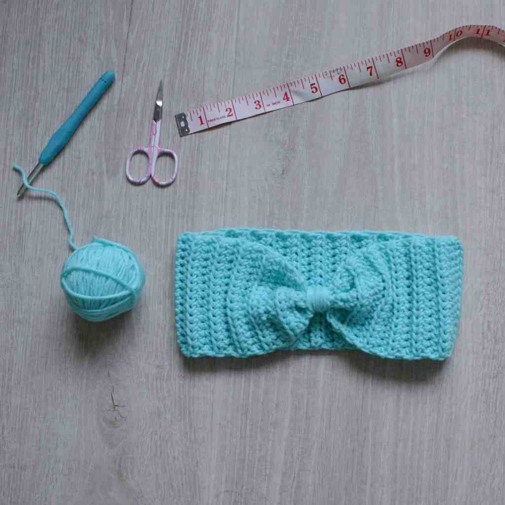 Crochet ear warmer,ball if yarn, hook, scissors and tape measure