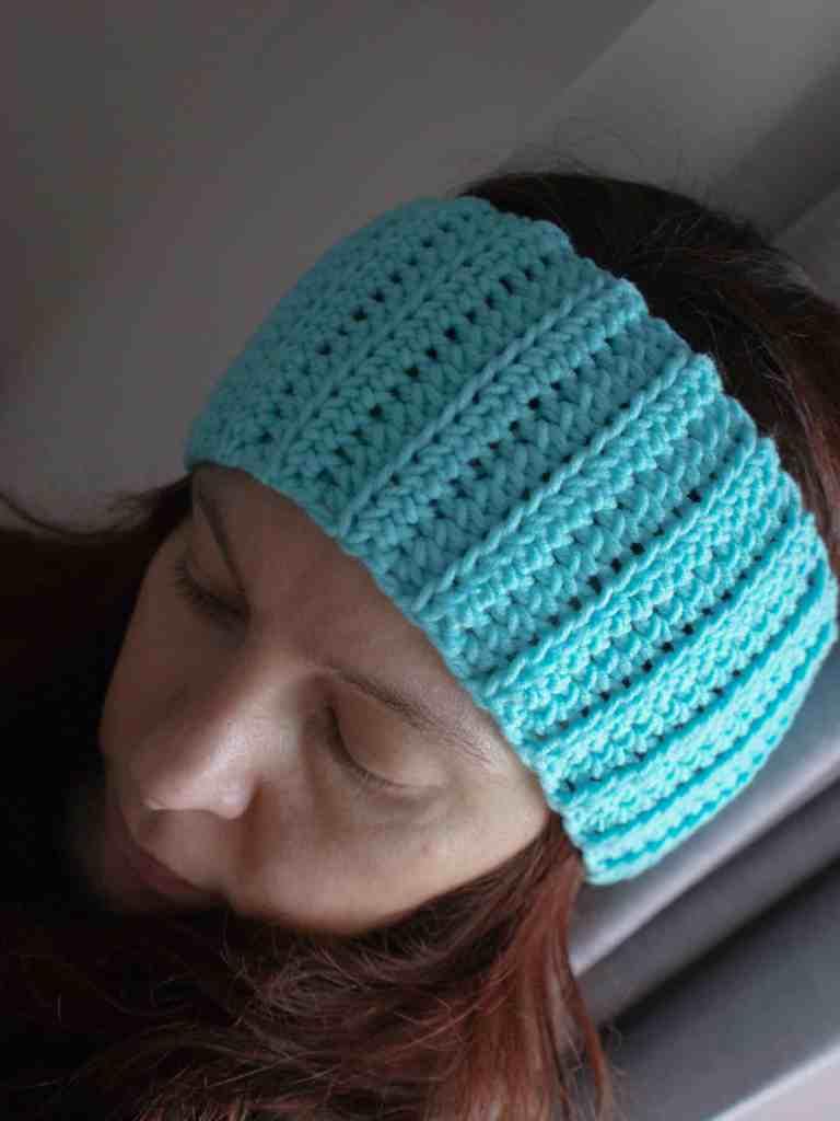 Woman wearing crochet ear warmer