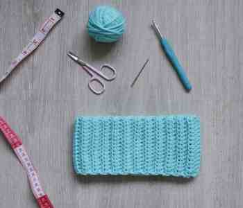 Ribbed crochet ear warmer tape measure scissors yarn crochet hook