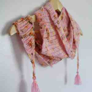 Pink leopard print crochet scarf with tassels on hangar