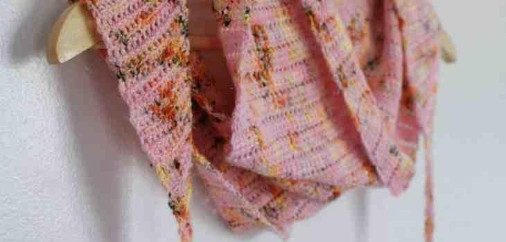 Pink leopard print crochet scarf with tassels on hangar