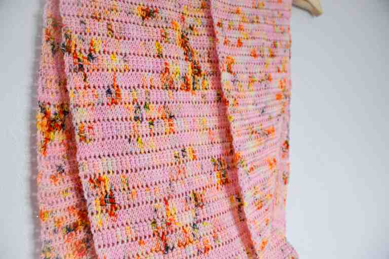 Pink leopard print crochet scarf on hangar