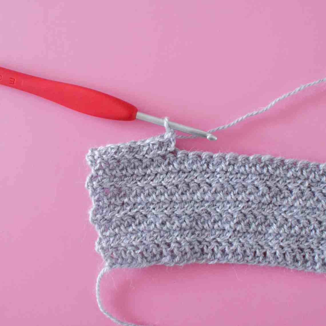 Herringbone Crochet Stitch Tutorial in Grey Alpaca Silk Yarn on a Pink Background