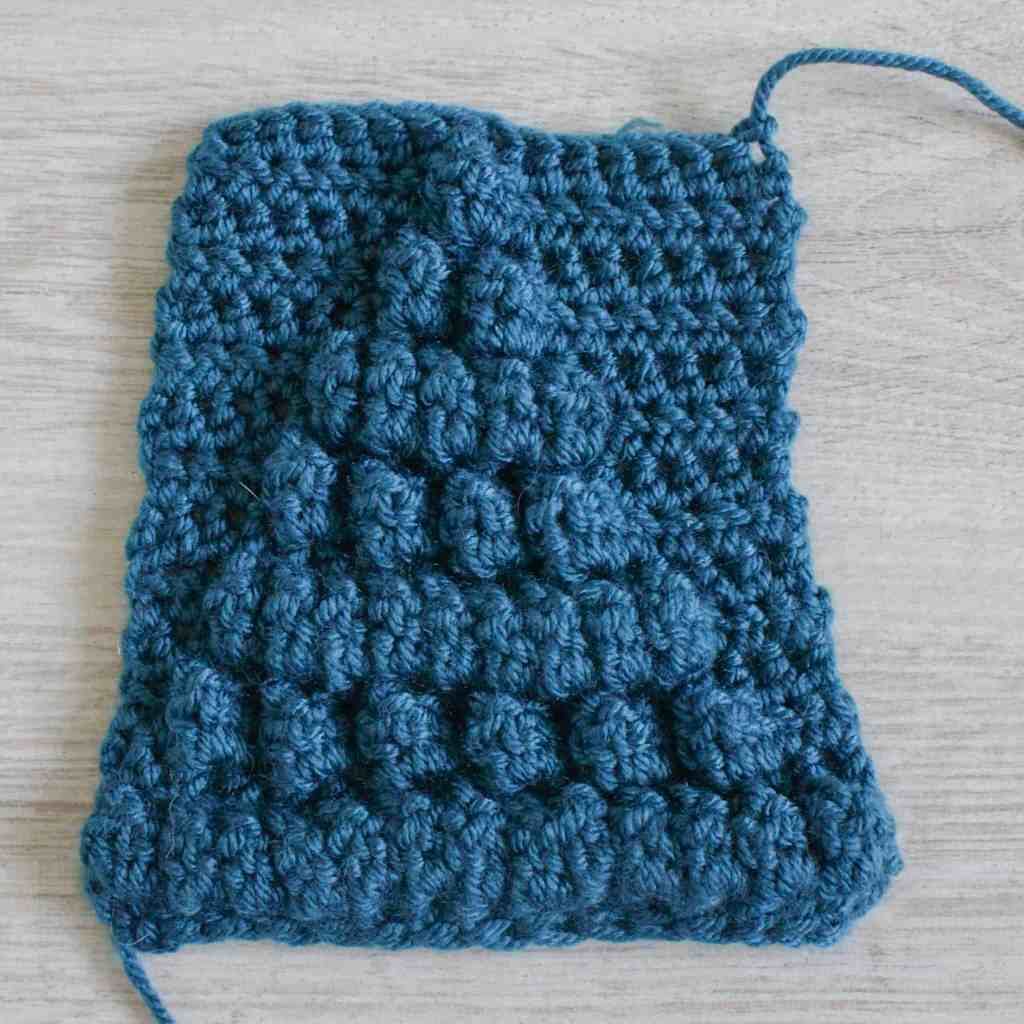 Front / right side of a blue crochet cluster stitch swatch