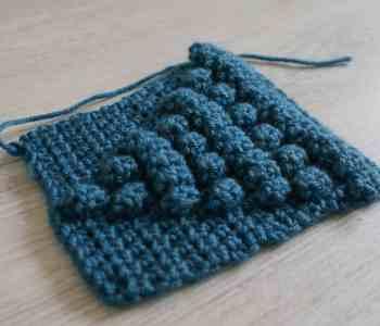 Blue crochet popcorn stitch swatch