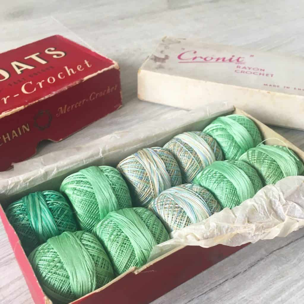 Green vintage crochet threads in a red box
