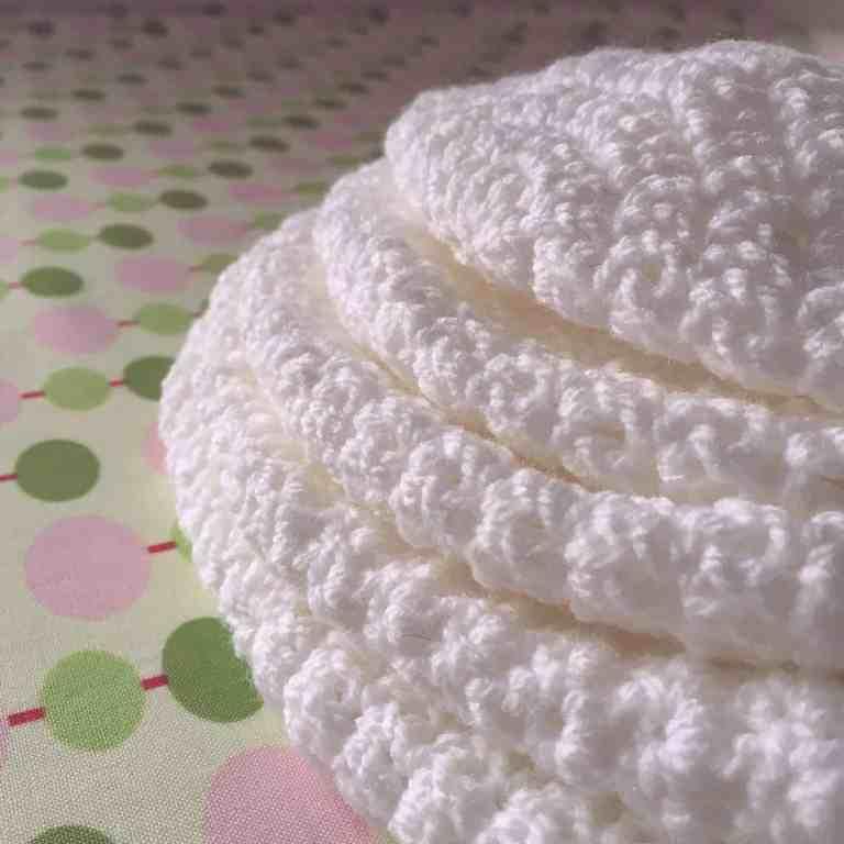 pile of white crochet hat crowns
