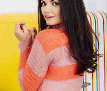 Woman in pink and red mohair sweater