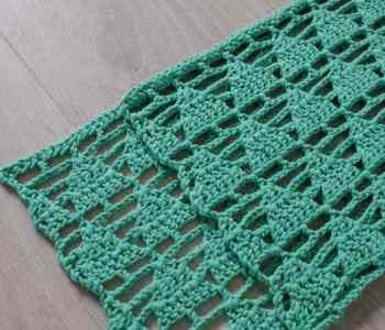 Green crochet fabric with triangle design