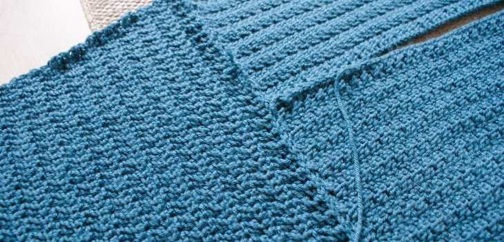 close up of crochet panels being joined