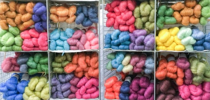 Lashings and lashings of multi coloured yarn in square shelves