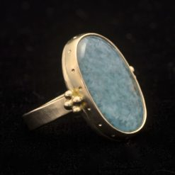gold ring with large oval quartz blue
