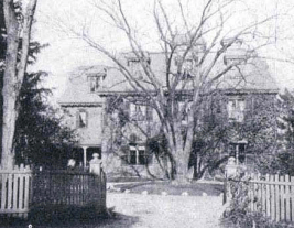 The Dorchester School for Girls ca. 1898. This is a black and white photograph of the front of the school