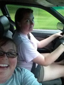 Mom and daughter driving a car