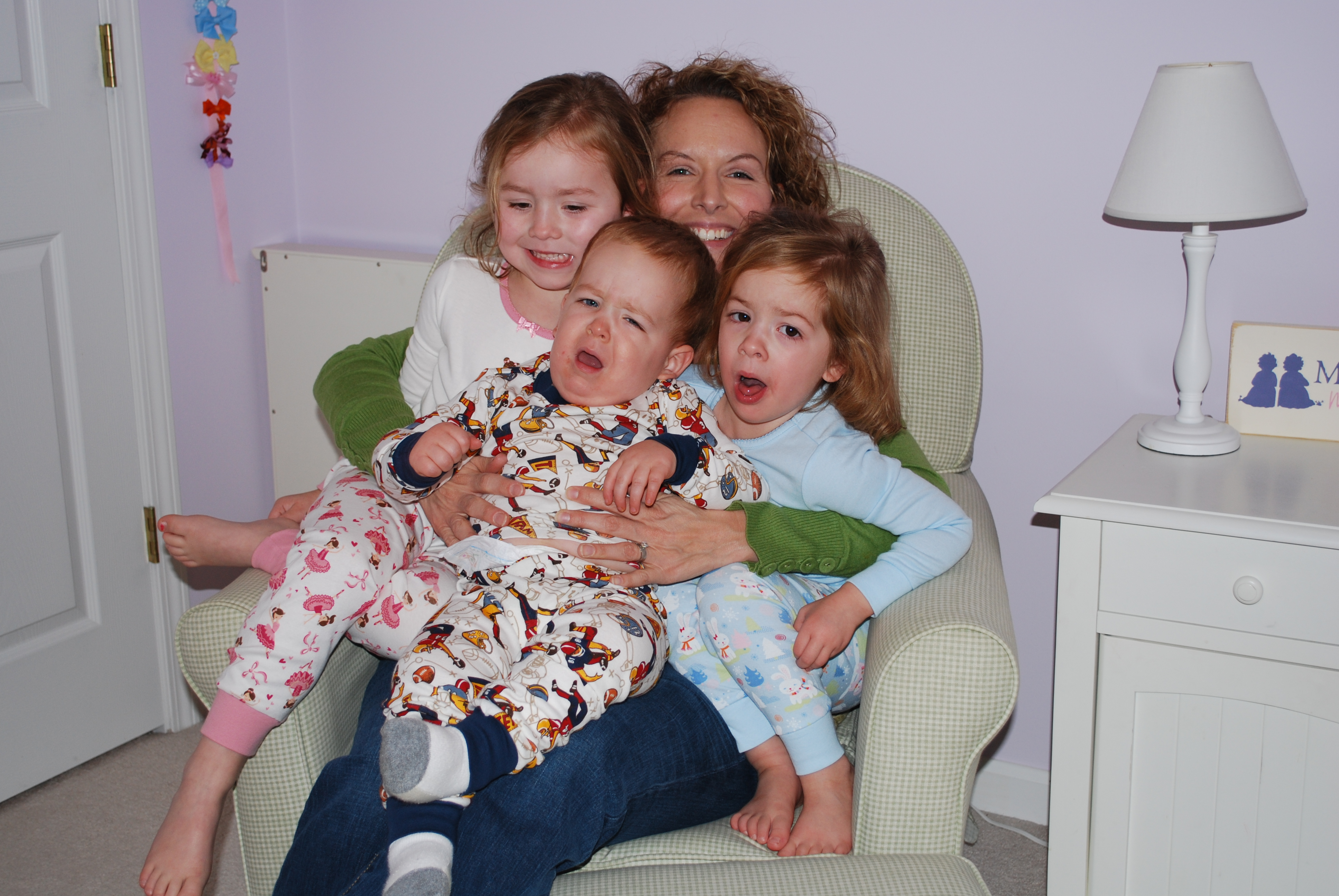 Me with the kids in our nursery chair...the only picture I have with me and the kids in the chair!  Crazy.