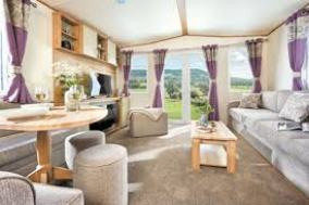 MODERN AND STYLISH LIVING ROOM WITH PATIO DOORS, FEATURE FIRE AND PULL OUT SOFA BED