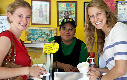 "USC Dornsife senior Amy Rogers (right) and classmate Olivia White sampled a few ice cream flavors at Mateo's Ice Cream in Los Angeles. The trip was one of several that Rogers made to restaurants, mercados and street vendors in neighboring cities throughout L.A. as part of lecturer in Spanish and Portuguese in USC Dornsife Sarah Portnoy's course, ""The Culture of Food in Hispanic Los Angeles."" Photo courtesy of Amy Rogers."
